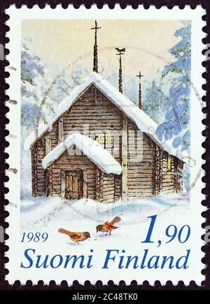 FINLAND - CIRCA 1989: A stamp printed in Finland from the 'Christmas' issue shows Sodankyla Church, Lapland, circa 1989. - Stock Photo