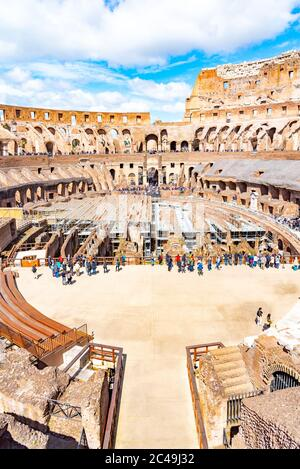 ROME, ITALY - MAY 6, 2019: Interior of Colosseum, aka Coliseum or Flavian Amphiteatre - the biggest amphitheatre of the Worldlocated in the centre of Rome, Italy. - Stock Photo