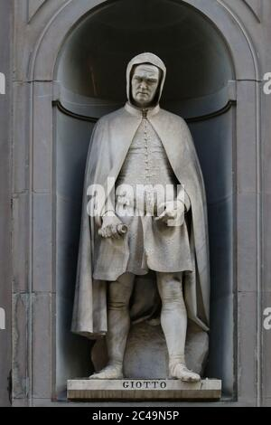 Statue of Giotto, famous painter and architect, outdoor of the Uffizi Museums, Florence, Italy, touristic place - Stock Photo