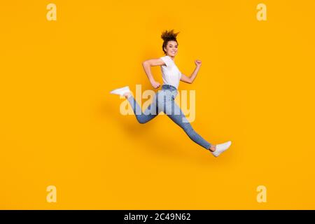 Full length body size view of her she nice attractive lovely sporty cheerful cheery girl jumping running marathon distance isolated on bright vivid - Stock Photo