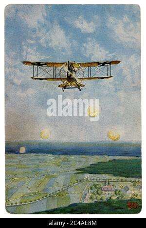 German historical postcard: German biplane with black crosses under fire from anti-aircraft artillery. Shell bursts, world war one 1914-1918. Germany - Stock Photo