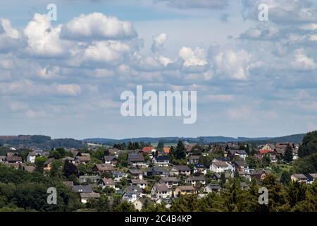 view over a village, rooftops, hills in the background, outdoors - Stock Photo