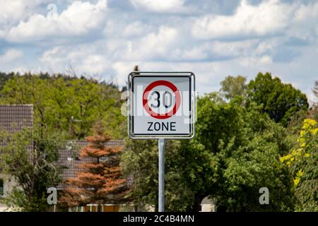 German road sign zone 30 km / h in a rural area, outdoors