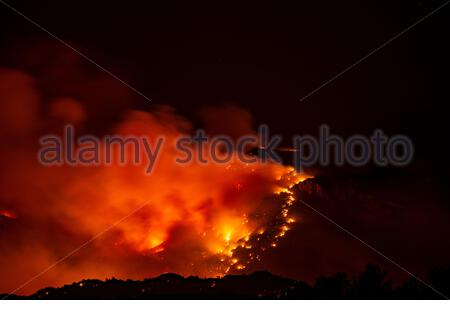 June 24th 2020 near Oracle, Arizona, the Bighorn Fire races up the ridge just above Biosphere 2 in Canada Del Oro Canyon.  As of tonight the fire in the Santa Catalina Mountains is 74,547 acres and 33 percent contained. On June 5, 2020 at 10:22PM a lightning strike started the Bighorn Fire in the Catalina Mountains northwest of Tucson, Arizona on the Coronado National Forest. Dry, windy conditions have pushed the fire closer to communities and is now forcing evacuations. Search Keywords Willett and Fire to see my other photos of the Bighorn Fire. - Stock Photo