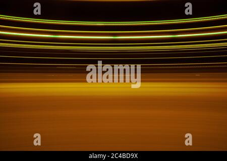 texture of lights and colors that expresses the concept of speed, vertigo, vortex, light, whirling, dizziness, drunk, intoxication, drug, drug addict, - Stock Photo
