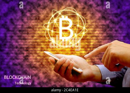 Blockchain technology concept, Businessman holding smartphone and virtual system diagram bitcoin. - Stock Photo