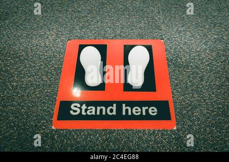 Stand here symbol in security checkpoint at airport. - Stock Photo