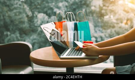 Woman using credit card with shopping online concept at cafe. - Stock Photo