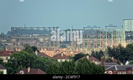Glasgow, Scotland, UK 26th  June, 2020: UK Weather: Sunny end to the day as the gasometers in kelvindale contrast with the semi detached of the suburb of temple. Gerard Ferry/Alamy Live News - Stock Photo