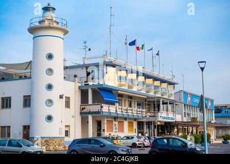 Dock and lighthouse port of Viareggio Tuscany famous carnival and luxury yachts - Stock Photo