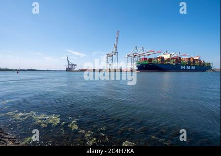 HMM Oslo docked at Southampton, Hampshire, England, United Kingdom seen from Marchwood. - Stock Photo