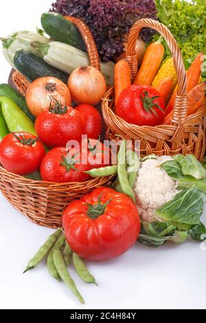 Freshly picked organic vegetables. Baskets with vegetables as the concept of biological, bioproducts, bio ecology, from the home garden healthy food. - Stock Photo
