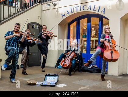 Classical Buskers Have Fun in Covent Garden, London - Stock Photo