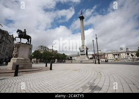 London, UK. 27th June, 2020. Trafalgar Square, with the National Gallery in the distance, is very quiet for a Saturday lunchtime in June, most probably due to the COVID-19 pandemic meaning people are staying away. Credit: Paul Marriott/Alamy Live News