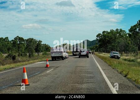 Townsville, Queensland, Australia - June 2020: Police attend an accident on the bruce Highway and direct traffic flow