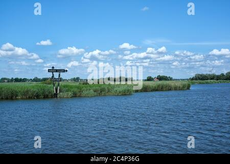 Europa, Netherlands - Tour of the canals of Friesland, view of the canal from the wheel of a boat, a signpost to the port of Ijlst Stock Photo