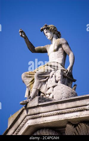 Statue of the ancient Greek god Apollo on the pediment above the famous Ashmolean Museum in Oxford, England. - Stock Photo