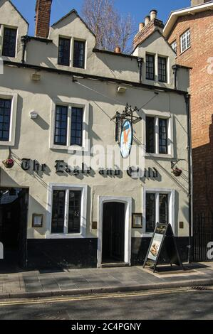 Oxford, UK - March 26, 2012: Exterior of the famous Eagle and Child public house in the middle of Oxford.  The Inklings authors used to drink here inc - Stock Photo