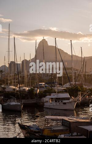 Beautiful view to Corcovado Mountain behind sailboat masts, Rio de Janeiro, Brazil - Stock Photo