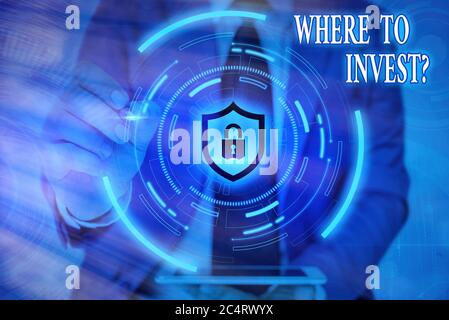 Writing note showing Where To Invest Question. Business concept for fundraising money to start business project startup Graphics padlock for web data - Stock Photo