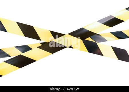 Yellow and black boundary tape on a white isolated background. - Stock Photo