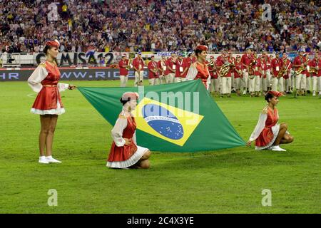 Girls with brazilian flag while hymn playing before the friendly game Croatia - Brazil in summer 2005 - Stock Photo