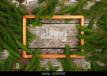 Christmas background for greeting card. wooden frame and Fir branches on wooden background. - Stock Photo