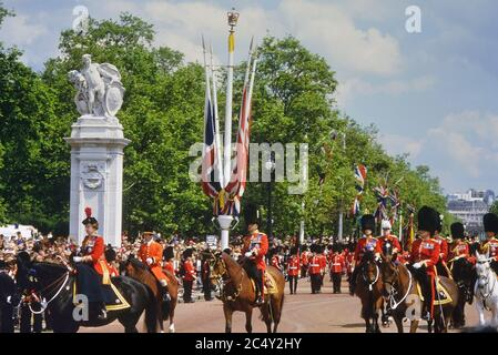 HM The Queen, followed by Prince Philip, leading the Trooping the Colour down The Mall on her horse Burmese. London. UK. Circa 1980's - Stock Photo