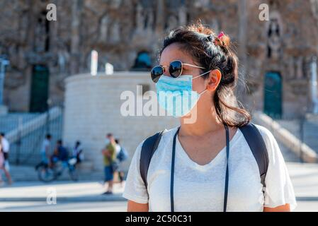 young tourist wearing face mask sightseing in european city. traveling and tourism industry during the corona virus pandemic and covid19 disease, affe