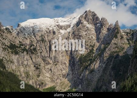 Snowcapped mountain Hoher Goell with its west face and Pflughoerndl to the right at Berchtesgaden national park, Bavaria, Germany - Stock Photo