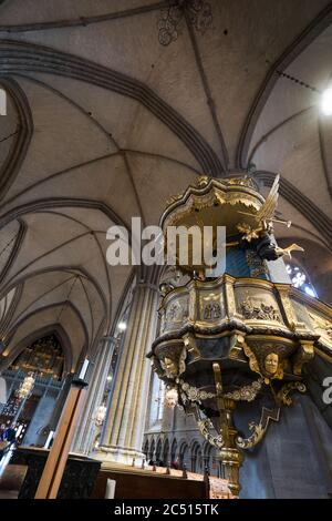 Interior of the Cathedral with the richly decorated and gilded pulpit in Swedish town Linkoping. Vertical image - Stock Photo