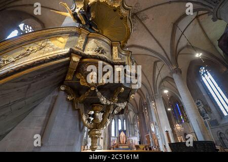 Interior of the Cathedral with the richly decorated and gilded pulpit in Swedish town Linkoping - Stock Photo