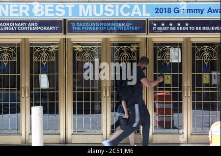 (200630) -- NEW YORK, June 30, 2020 (Xinhua) -- Pedestrians walk past a closed Broadway theater in New York, the United States, June 29, 2020. The Broadway League announced on Monday that Broadway performances in New York City will be suspended through the remainder of 2020 due to COVID-19. Broadway theatres are now offering refunds and exchanges for tickets purchased for all performances through January 3, 2021. Broadway performances were suspended on March 12, 2020. (Xinhua/Wang Ying) - Stock Photo