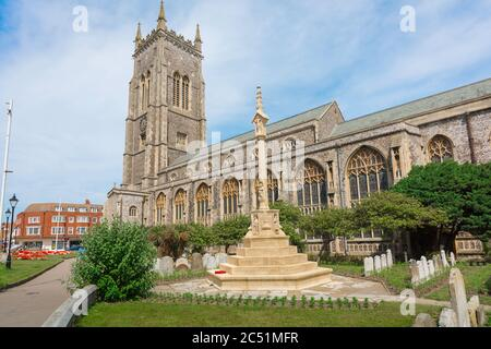 Cromer Norfolk church, view of St Peter and St Paul Parish church and its churchyard cenotaph in the north Norfolk seaside town of Cromer, England, UK - Stock Photo