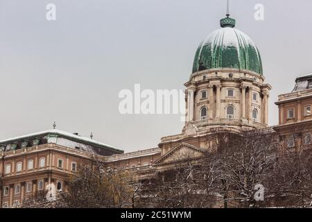Dome of the snowy Buda Castle Royal Palace with in Budapest, Hungary at winter time - Stock Photo
