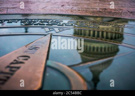 The United States Capitol Dome reflected in water - Stock Photo