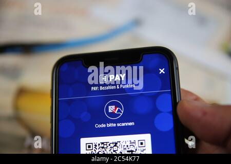 Viersen, Germany - June 30. 2020: Close up of mobile phone screen hold by male hand with Payback Pay app for contactless electronic online payment (fo - Stock Photo