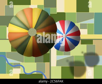 Hot air balloons float high above farmland in a view looking down from above. - Stock Photo