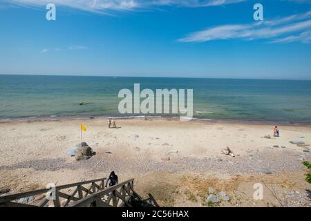 An overview look at the rocky beach next to the Baltic sea on a sunny, summer day. In Palanga, Lithuania. - Stock Photo