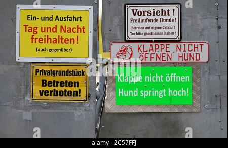 Various signs warn of entering the property, Stuttgart, Baden-Württemberg, Germany - Stock Photo