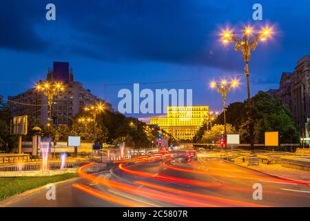 Building of Romanian parliament in Bucharest in a beautiful summer night, Bulgaria - Stock Photo