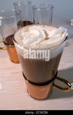 Still Life of homemade Irish Coffee in a copper, brass and glass decorative mug, USA - Stock Photo