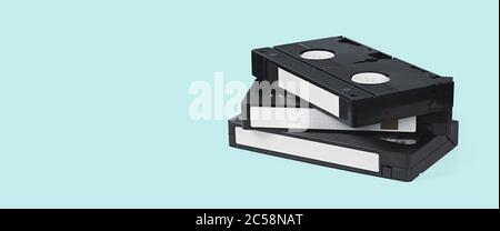 VHS video tapes on a blue background with clipping path - Stock Photo