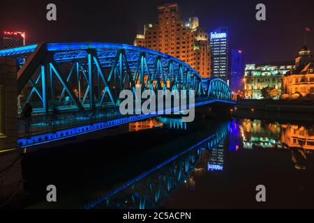 View on colorful illuminated Waibaidu bridge in Shanghai at night - Stock Photo