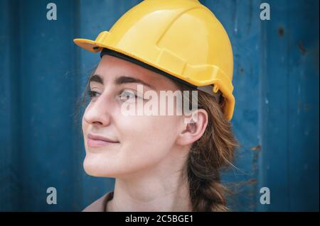 Portrait of Confident Transport Engineer Woman in Safety Equipment Standing in Container Ship Yard. Transportation Engineering Management and Containe