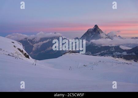 First rays of sun on Matterhorn, Alps - Stock Photo