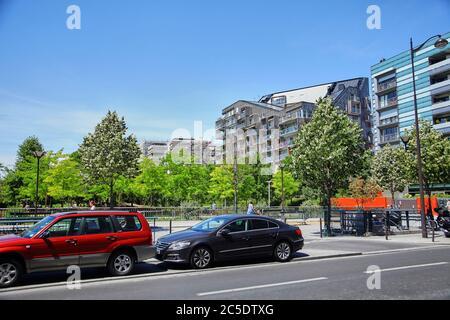 Paris, France - June 28, 2015: Eco-Quartier Clichy-Batignolles. New Modern Architecture. Park Martin Luther King. Parked cars