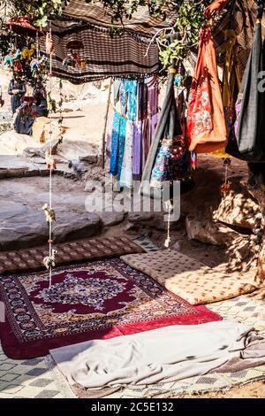 Tourist souvenirs on display in Siq Al-Barid or Little Petra in Jordan. - Stock Photo