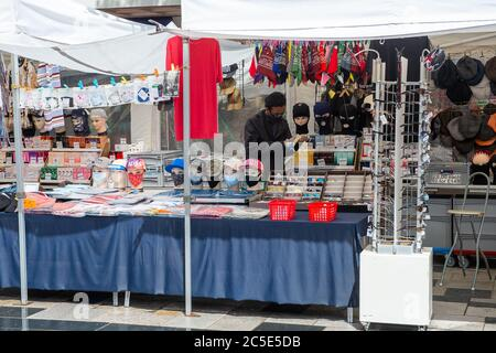 Slough, Berkshire, UK. 2nd July, 2020. A stall holder selling face masks in Slough High Street, Berkshire awaits customers on a rainy day today during the Coronavirus lockdown. Credit: Maureen McLean/Alamy - Stock Photo