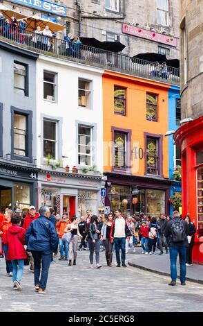 Colorful shopfronts and tourists at the famous Victoria Street in Edinburgh